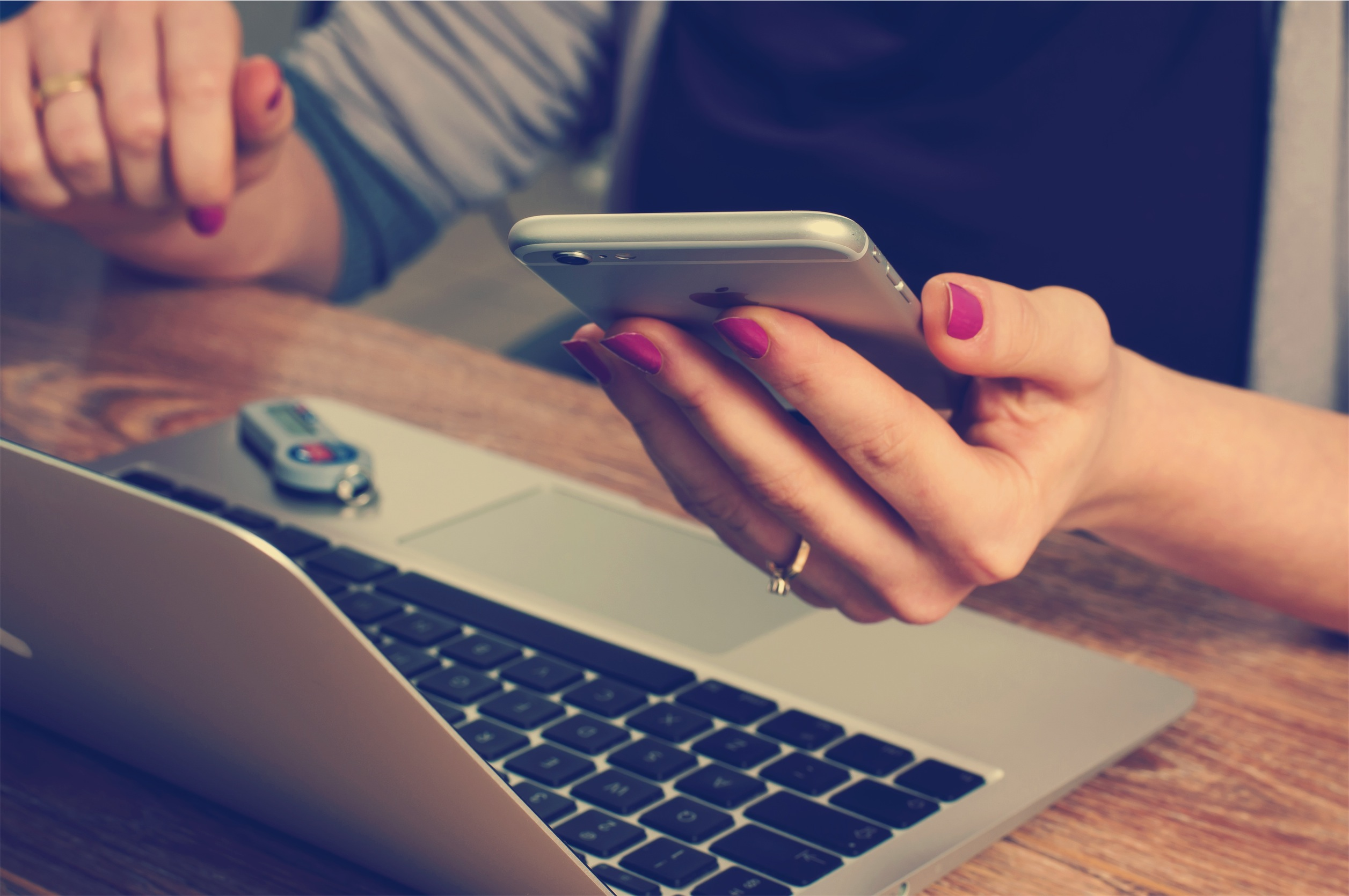 Content strategy inspiration – holding phone next to laptop