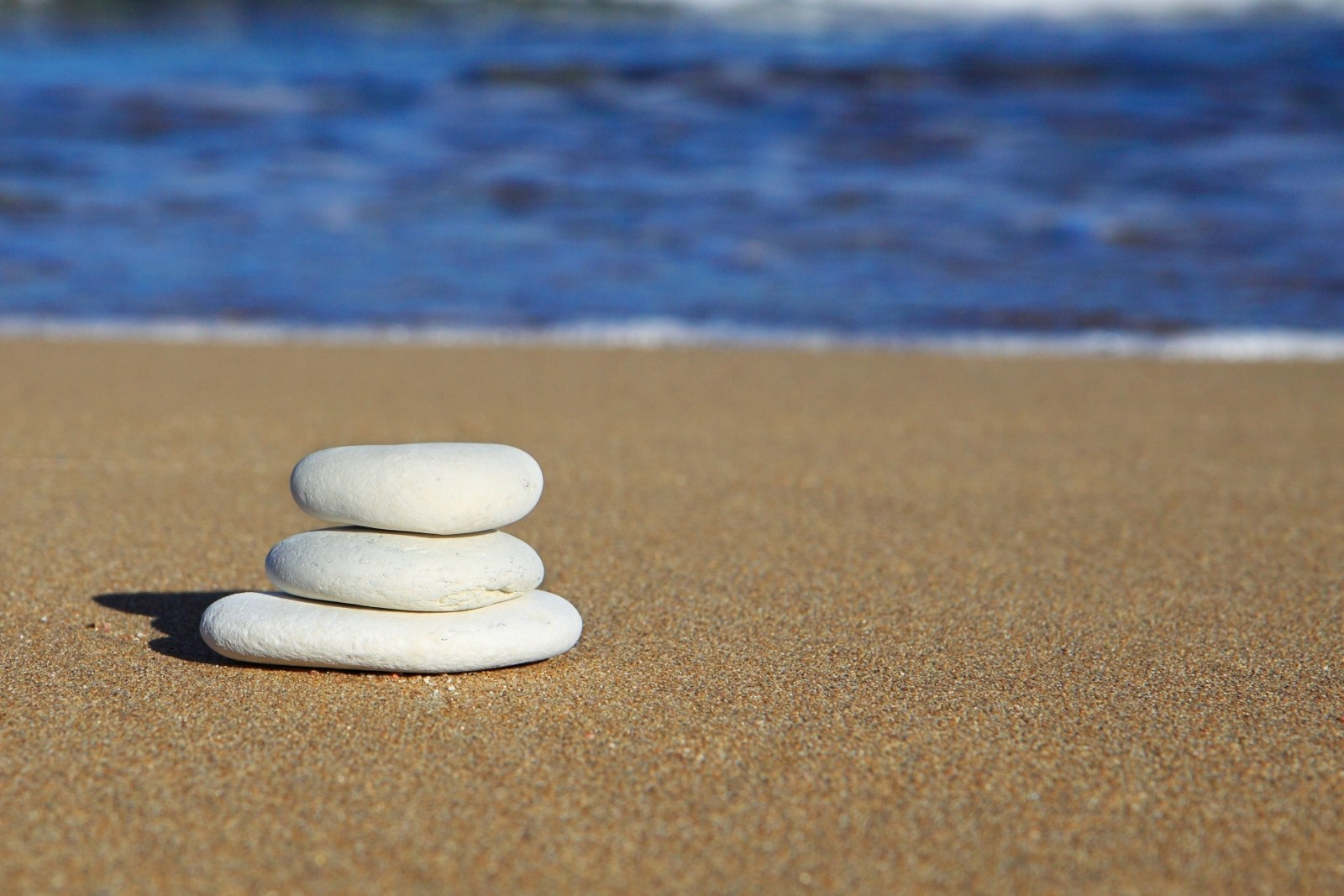 stack-of-white-pebbles-on-beach