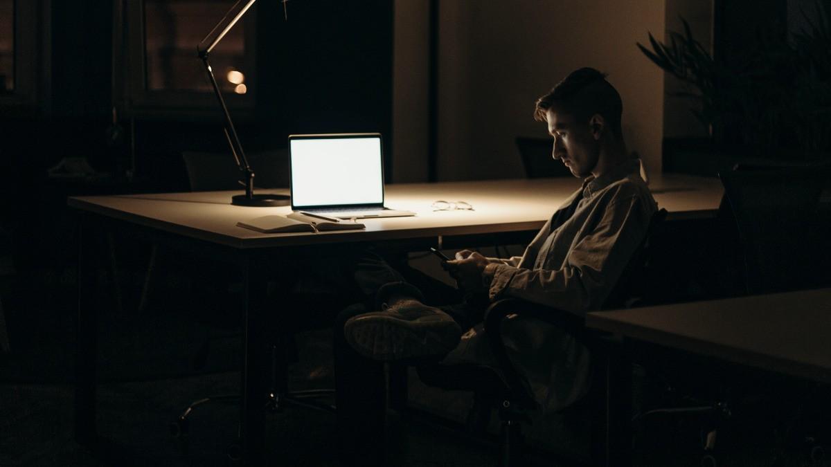 man sitting alone in dark