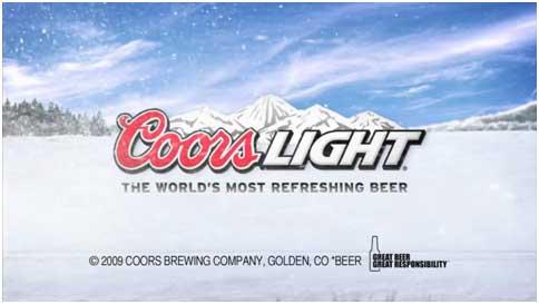 слоган пивоваренной компании У нас самое освежающее пиво в красном и белом цвете на фоне снежной долины