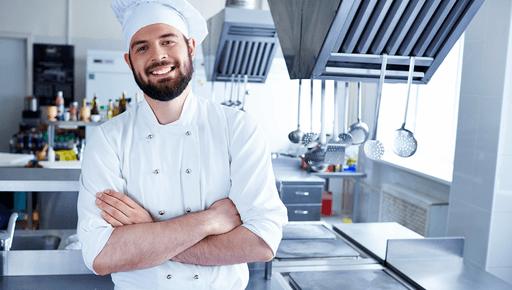 restaurant website builder image with happy chef in kitchen